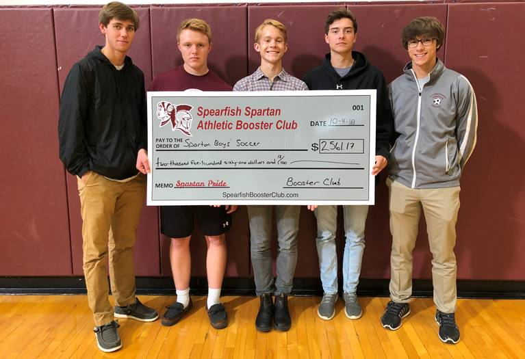 The Spearfish Spartan Athletic Booster Club presented a check in the amount of $2,561.17 to the Spearfish High School Boys' Soccer team for the purchase of practice shorts and travel polo shirts. The Booster Club's mission is to recognize student athletes and boost school spirit and community pride. Congratulations on a phenomenal season, and good luck in post-season play. Pictured are senior soccer players From left to right: Elijah Riggs, Timothy Doerges, Jay Sayler, Weston Verhulst, Gene Glover.